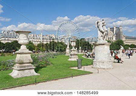 PARIS, FRANCE-AUGUST 09, 2016: Parisians and tourists in Tuileries garden (Jardin des Tuileries)