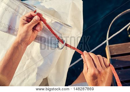 User knitting knots. Bowline knot. Process of tying Bowline process is a top view on the sail.