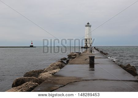 A lighthouse at the end of a breakwater.  Frankfort, MI