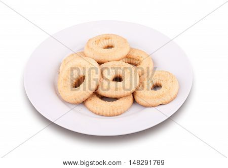 A few tea cookies on a plate isolated on white background.