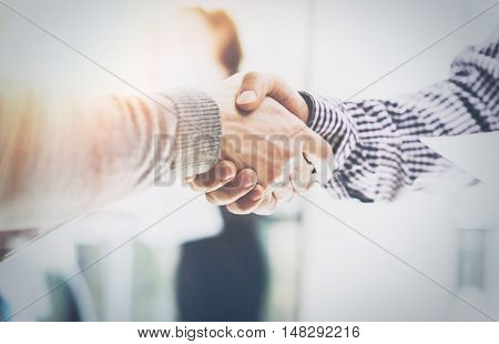 Business Partnership Meeting.Photo Two Businessmans Hands Handshake Process.Successful Businessmen Handshaking After Excellent Corporate Deal.Horizontal, Blurred Background