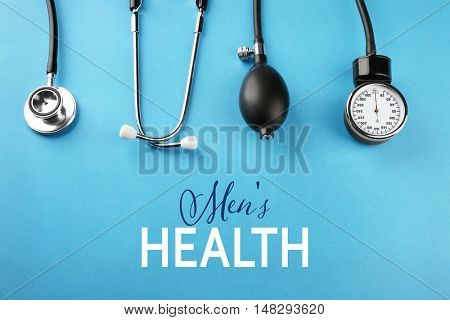 Medical manometer and a stethoscope on blue background. Urology concept
