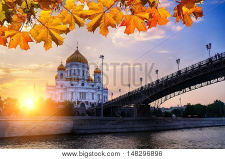 Cathedral of Christ the Saviour and Patriarshy bridge in sunset in Moscow Russia - Moscow autumn view. Moscow landmark. Moscow architecture landscape. Autumn in Moscow. Moscow architecture landmark.