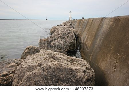Rocks in front of the Frankfort breakwater and lighthouse.  Michigan