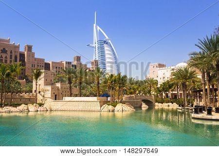 DUBAI, UAE - 1 APRIL 2014: View for Burj Al Arab hotel from the Madinat Jumeirah in Dubai, UAE. Burj Al Arab with 321 meters high is the most luxurious 7 star hotel and a symbol of modern Dubai.