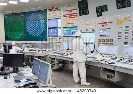 KURCHATOW, RUSSIA - JUNE 23, 2016: The operator monitors the readings of devices and work equipment. Central control unit of Kursk NPP.