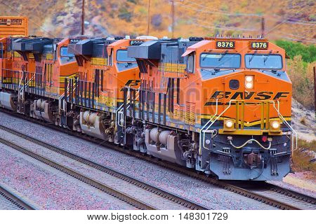 September 19, 2016 in Cajon, CA:  BNSF Freight Train traveling southbound towards Los Angeles transporting commerce to Los Angeles and beyond taken in Cajon, CA where train enthusiasts can get great views of trains