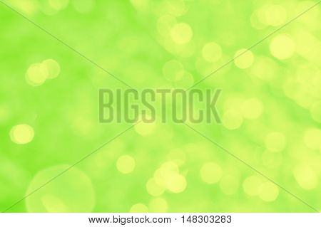 Abstract green background with yellow bokeh and patches of light