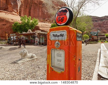 Gas pump stand museum and Historical automobile registration tags. Utah USA. May 20, 2016