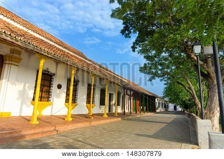 Beautiful tree lined colonial street in Mompox Colombia