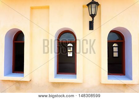 Five windows and a street light on a colonial church in Mompox Colombia