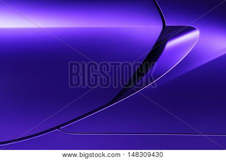 Bodywork of lilac sedan, surface of sport car door and handle in ultramodern style, detail of concept racing vehicle