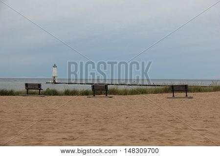 Three benches overlooking the Frankfort, Michigan lighthouse.