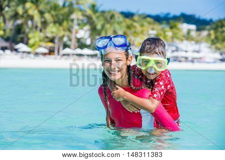 Photo of happy snorkeling kids in pink swimwear