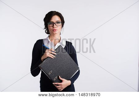 Attractive caucasion business woman in her 20s shot in studio isolated on a white background.