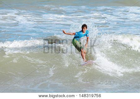 Cabedelo Paraiba Brazil - September 18 2016 - Child surfs in Intermares Beach