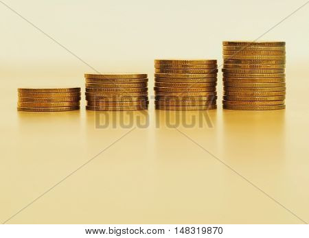 Stack of golden coins growing up stack. Growth business and financial concept.