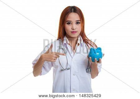 Young Asian Female Doctor Point To A Pig Bank Coin.