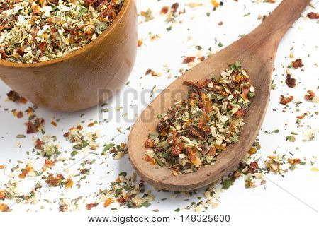 Chimichurri Herbs into a spoon isolated in white background