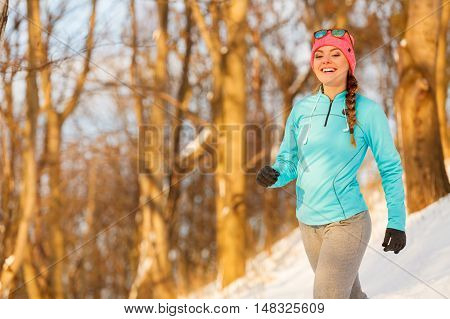 Girl Exercising In Winter Clothing