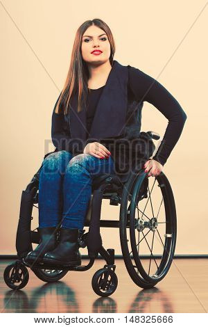 Disabled Young Girl On Wheelchair.