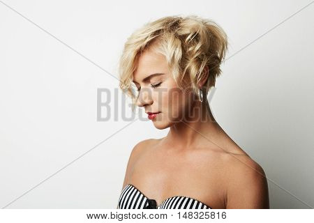 Portrait Handsome Young Woman Blonde Hair Wearing Blue Jacket Empty White Background.Beauty Fashion People Photo.Pretty Girl Posing Closed Eyes Studio Shoot.Horizontal Image