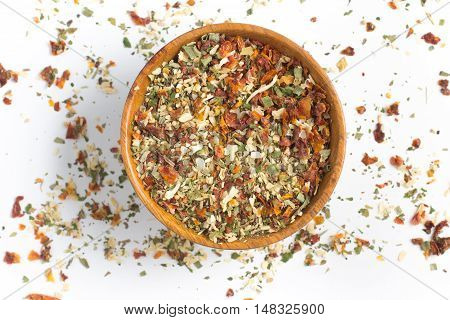 Chimichurri Herbs into a bowl isolated in white background
