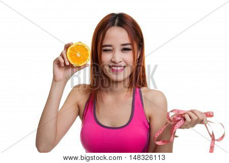Asian Healthy Girl On Diet With Orange Fruit And Measuring Tape.