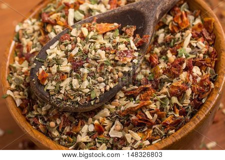 Chimichurri Herbs into a bowl over a wooden table