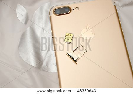 PARIS FRANCE - SEP 16 2016: New Apple iPhone 7 Plus unboxing in the first day of sales - iinsering SIM card in new phone. New Apple iPhone acclaims to become the most popular smart phone in the world in 2016