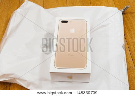 PARIS FRANCE - SEP 16 2016: New Apple iPhone 7 Plus unboxing in the first day of sales - iPhone 7 plus box before unboxing. New Apple iPhone acclaims to become the most popular smart phone in the world in 2016