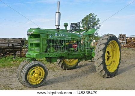 ROLLAG, MINNESOTA, Sept 1. 2016: A restored H Farmall painted John Deere green is displayed at the West Central Steam Threshers Reunion in Rollag, MN attended by 1000's held annually on Labor Day weekend.