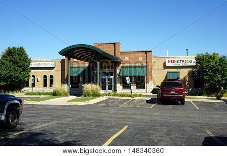 PLAINFIELD, ILLINOIS / UNITED STATES - SEPTEMBER 19, 2016: One may receive medical care at  the Family Medicine Walk In Clinic, and brings one's children to Kids First Pediatrics, in Plainfield.
