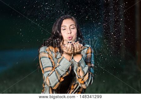 Teenage Girl Caucasian Blowing Glitter From Her Hands Sitting
