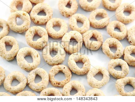 Whole weat circular cereal Os on white background