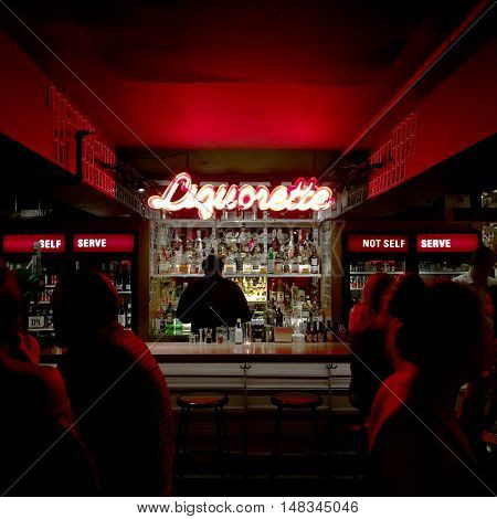 NEW YORK NY - JULY 15th 2016: Neon sign at Eben Freeman's basement bar Genuine Liquorette in Chinatown New York serving trendy drinks like the Cha-Chunker