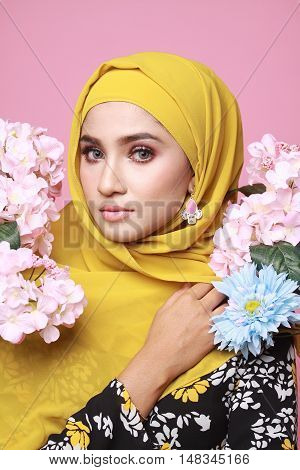 muslimah model in fashionable dress isolated in pink background