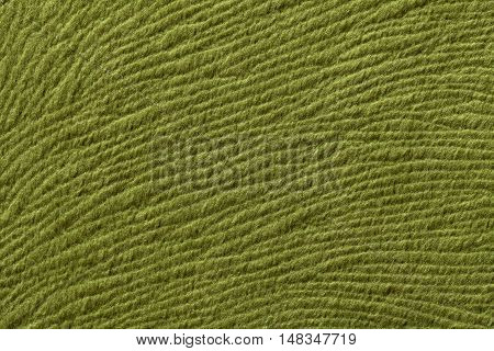 Green olive background from a soft wool textile material closeup. Fabric with natural texture. Cloth backdrop.