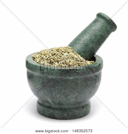 Organic Fennel seed (Foeniculum Vulgare) on marble pestle. Isolated on white background.