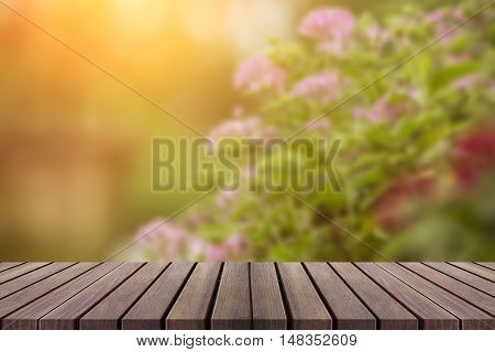 Blur Flower At Garden With Wood Table For Dicut ,montage