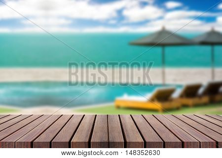 Wood Table Top On Blur Beach Background With Beach Chairs And Parasol - Can Be Used For Display Or M