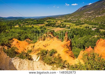 The reserve - pit on production ochre. Orange and red picturesque hills. Languedoc - Roussillon, Provence, France