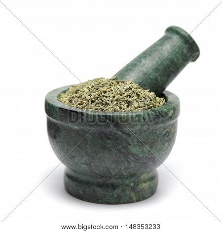 Organic Aniseed (Pimpinella anisum) on marble pestle. Isolated on white background.