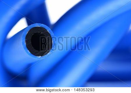 Blue pressure hose on isolated white background