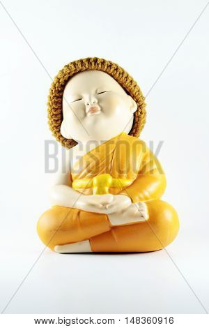 Buddhist novice doll pottery monk on white background