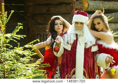 Santa Claus And Pretty Girls Outside