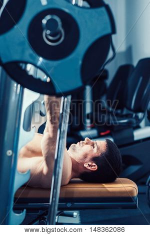 Man Exercising On The Bench Press