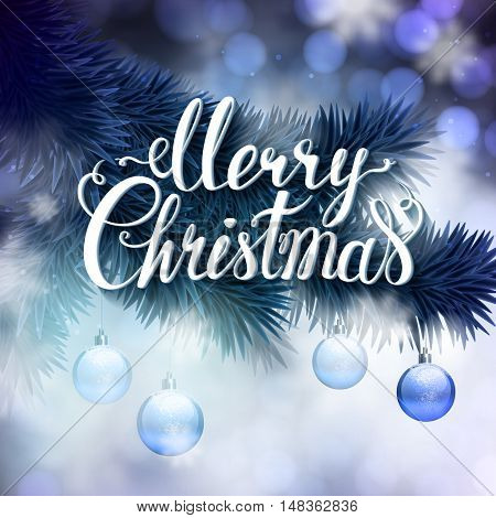 Blue Christmas greeting card with fir-tree branch, evening balls and big white hand-drawn inscription Merry Christmas on it.
