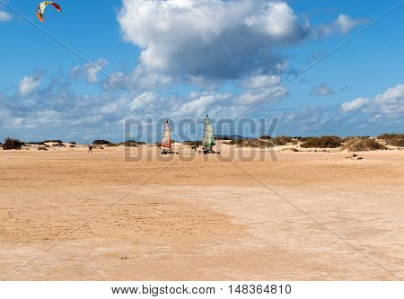 FUERTEVENTURA SPAIN - SEPTEMBER 15, 2015:People driving sand yachting on the beach. They are learning and having fun.Corralejo Fuerteventura