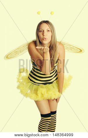 Woman wearing bee halloween costume